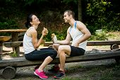 Eating together -  couple after sport training