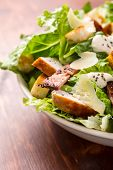 pic of caesar salad  - Bowl of Traditional Caesar Salad with Chicken and Bacon - JPG