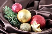 Beautiful Christmas decor on brown satin cloth