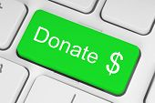 foto of soliciting  - Green donate button on the keyboard close - JPG