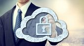 stock photo of safeguard  - Secure online cloud computing concept with businessman - JPG