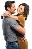 Happy couple in shirt and dress hugging isolated on white