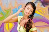 Beautiful young woman with headphones relaxing and listening to music.