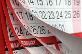 stock photo of turn-up  - Months and dates shown on a calendar whilst turning the pages - JPG