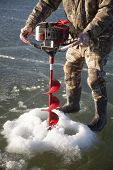 Man In Camo Drilling Hole In Ice Body