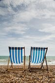 Two Deck Chairs On Brighton Beach, England