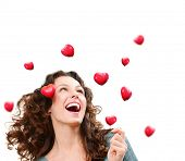 Beauty Young Woman Catching Valentine Hearts. Love Concept. Beautiful Joyful Girl Laughing. Valentines Day.