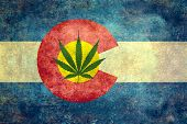 image of marijuana  - Vintage distressed retro version of the Colorado State flag with Marijuana leaf in center  - JPG