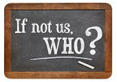 if not us, who - question on a vintage slate blackboard, isolated on white