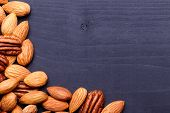 pic of pecan nut  - Background texture of assorted mixed nuts including cashew nuts pecan nuts almonds - JPG