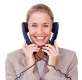 Businesswoman Tangled Up In Phone Wires