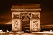 Arc de Triomphe, Paris, France. View from Avenue des Champs-Elysees. Vintage retro style, monochrome