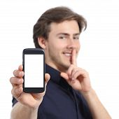 Man Showing Mobile Phone Screen And Asking For Silence