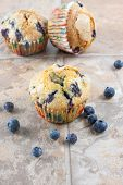 Blueberry Muffins On A Tile Countertop.