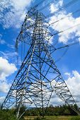 foto of utility pole  - Side View Of High Voltage Poles On Blue Sky - JPG