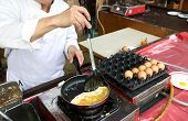 A Chef Is Cooking An Omelet For A Breakfast