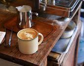 Beautiful Coffee Art In An Enamel Mug