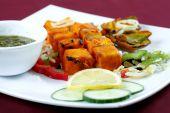 image of paneer  - paneer tikka in plate for dinner time at home  - JPG