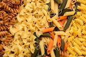 Closeup of a variety of different sizes and shapes of Italian pastas.