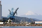 Crane At An Oil Mill With Mt. Fuji In Background