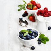 Berries in bowls  on Wooden Background. Strawberries, Raspberries and  Blueberries.  Health, Diet, Gardening, Harvest Concept