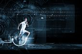 stock photo of cardio exercise  - Young running man against digital media background - JPG