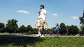 Family walking in a park under the blue sky