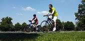Father and son cycling in the park