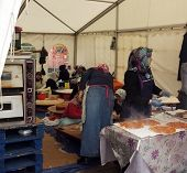Turkish women cook in a tent