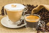 Cappuccino And Espresso In Glassy Cups With Roasted Coffee Beans