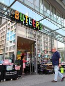 BERLIN, GERMANY - JUNE 11, 2014: Pedestrians walk past a Butlers home accessories store in  Berlin,