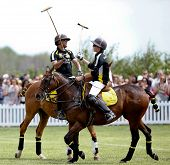 JERSEY CITY, NJ-MAY 31: Hilario Figueras (R) and Bash Kazi click mallets during the polo match at th