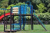 stock photo of pubic  - children playground at pubic park in summer season - JPG
