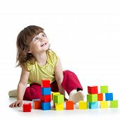 foto of pretty-boy  - smiling kid girl playing building block toys - JPG