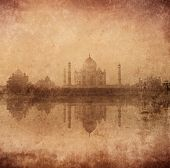 Vintage retro hipster style image of Taj Mahal with reflection in Yamuna river panorama in fog, Indi