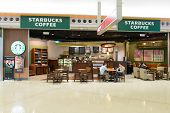 HONG KONG - APRIL 01: Starbucks cafe  in airport on April 01, 2014 in Hong Kong, China. Starbucks Co