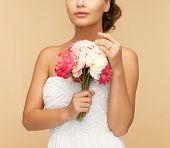 picture of young woman with bouquet of flowers