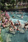 Russians And Other Tourists Swim In The Thermal Pools