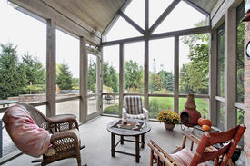 foto of screen-porch  - Screen porch in luxury home with patio view - JPG