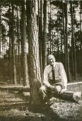GERMANY, CIRCA 1930: Vintage photo of man in forest
