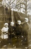 GERMANY, CIRCA 1930:  Vintage photo of four children outdoor