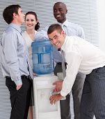 Confident Multi-ethnic Business People Interacting At A Watercooler