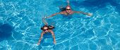 Couple Swimming In Pool
