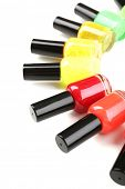 Colorful nail polishes isolated on white