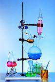 Laboratory glassware on light blue background