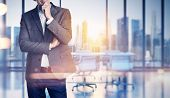 foto of horizon  - Businessman on blurred city and office background - JPG