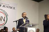 Rev Al Sharpton addresses rally