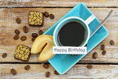 Happy birthday card with cup of coffee, fortune cookie and chocolates