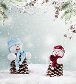 Winter holiday happy snow men with blur landscape on background