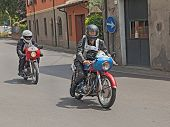 Bikers Riding A Vintage Ducati And Motobi